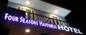 Four Seasons Happiness Hotel